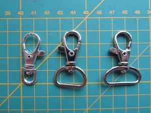 musketonhaken, D-ring, sleutelring, passant, schuifgesp