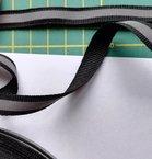 1 cm breed ribsband met reflecterende streep op zwart