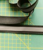 2 cm breed ribsband met reflecterende streep op zwart