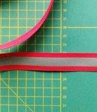 2 cm breed ribsband met reflecterende streep op rood
