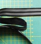 2 cm breed ribsband met twee reflecterende strepen op zwart