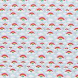 Toni: regenbogen en wolkjes op lichtblauwe katoen_