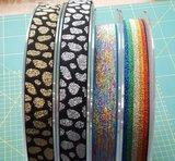 taille-elastiek 2,5 cm breed:goudrkleurige print op zwart /HALVE METER_
