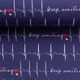 Toni: ECG print op donkerblauwe katoen met tekst: keep smiling_