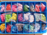 koffer en tang met 660 complete snaps _