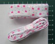 bosje biaisband: wit met roze figuurtjes en blauwe stippen