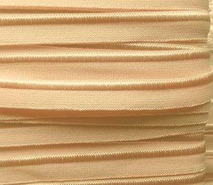 elastisch paspelband, creme met een licht zalmkleurig tintje