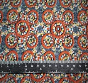 Lima, tricot met nep-borduursels op jeanskleur