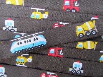 cementwagen, helikopter/metro, enz op donkerbruin / geweven sierbandje