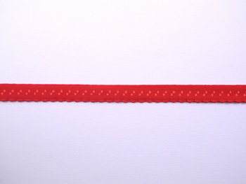 rood omvouwelastiek met klein schulprandje op de vouw