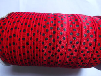 omvouwelastiek rood met zwarte stip
