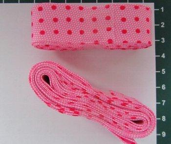 bosje biaisband: stip op honingraad roze