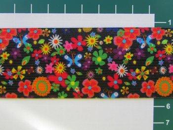 taille-elastiek 4 cm breed: kleine bloemetjes op zwart/ HALVE METER