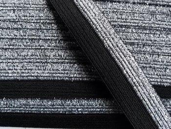 omvouwelastiek 1,6 cm breed met glitterband aan één kant / zwart
