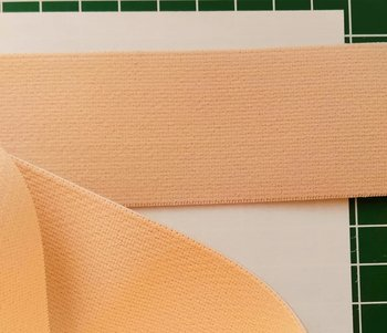 taille-elastiek 4 cm breed: zacht zalmkleurig /HALVE METER