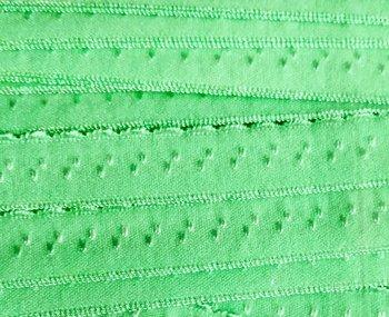 lichtgroen/mint omvouwelastiek met klein schulprandje op de vouw
