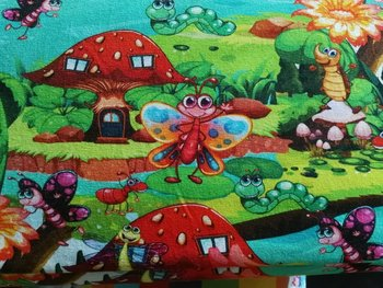 Tim: digitaal bedrukte tricot: prachtig bont schouwspel van fantasiediertjes tussen paddenstoelen enz..