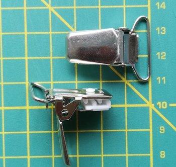 bretelclip, glanzend: zilverkleurig trapezevorm voor band 25 mm